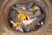 Burning charcoal in metal rim  — Stock Photo