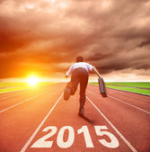 Happy new year 2015. businessman running with sunrise background — Stock Photo