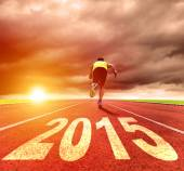 Happy new year 2015. young man running with sunrise background — Stock Photo