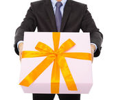 Businessman holding a gift box. isolated on white — Stok fotoğraf
