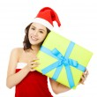 Happy young woman with a christmas gift box — Stock Photo #54130365