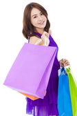 Asian smiling young woman holding shopping bag — Stock Photo