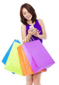 Young pretty woman holding a cell phone to shop online  — Stock Photo