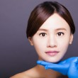 Asian beautiful woman gets injection in her face. aesthetic medi — Foto Stock #56047795