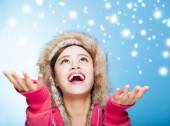 Happy young woman watching winter snow — Stock Photo