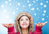 Happy young woman watching snow — Stock Photo