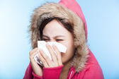 Young Woman catch a cold and sneezing nose with a sweater. isola — Foto de Stock