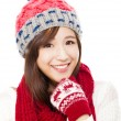 Close up of beautiful asian woman in hat, muffler and mittens. h — Stock Photo #56507743