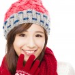 Close up of beautiful asian woman in hat, muffler and mittens. h — Stock Photo #56507745