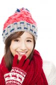 Close up of beautiful asian woman in hat, muffler and mittens. h — Stock Photo