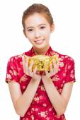 Happy young woman showing  gold for chinese new year — Stock Photo