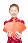 Beautiful young asian woman giving  red bags for rich  — Stockfoto