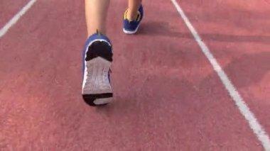 Runner running on the track in stadium — Stock Video