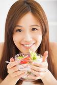 Beautiful girl eating healthy food salad — Stock Photo