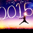 Happy new year 2015 . young man jumping and drawing — Stockfoto #59067837
