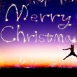 Young man jumping and drawing the merry christmas — Stock Photo #59067841