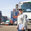 Happy driver in front of container truck — Stock Photo #62665647