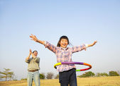 Happy kid playing  hula hoops outdoors — Stock Photo