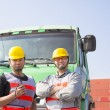 Two container workers with truck — Stock Photo #63724875