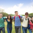 Happy group of students walking together — Stock Photo #65843801