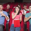Young people  watching a movie at the cinema — Stock Photo #65844195
