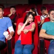 Young people  watching a movie at the cinema — Stock Photo #65844199