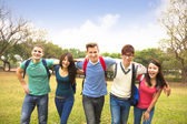Happy group of students walking together — Stock Photo