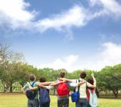 Happy young group of students watching the sky  — Stock Photo