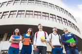 Happy group of students standing together  — Stock Photo