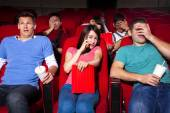 Young people  watching a movie at the cinema — Stock Photo