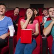 Happy Young people  watching a movie at the cinema — Stock Photo #66914153