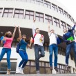 Happy young group of students jumping together  — Stock Photo #66914843