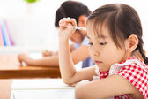 Little girl thinking in the classroom — Stock Photo