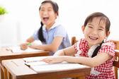 Happy children study in the classroom — Stock Photo