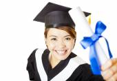 Top view happy young woman graduating holding diploma — Stock Photo