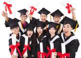 Group Of asian Students Celebrating Graduation — Stock Photo