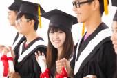 Beautiful asian female college graduate at graduation with class — Stock Photo