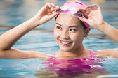 young woman close up portrait in swimming pool — Stock Photo