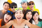 Group of smiling friends with camera  taking self photo — Stock Photo