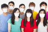 Young student group wearing a mask — Stock Photo