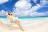 Happy woman with  laptop on the tropical beach — Stock Photo