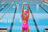 Young sportswoman stretching and preparing to swimming — Stock Photo