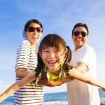 Happy family enjoy summer vacation on the beach — Stock Photo #74810785