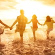 Group of happy young people playing on the beach — Stock Photo #76081959