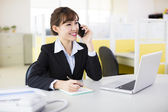 Businesswoman talking on the phone in the office — Stock Photo