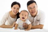 Happy family with smiling baby boy — Stock Photo