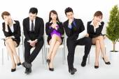 Bored business people waiting for interview — Stock Photo