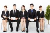 Happy business people sitting on the chairs — Stock Photo