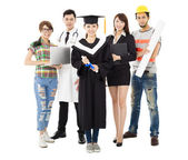 People in different occupations standing with graduation — Stock Photo