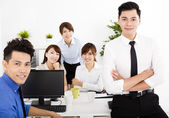 Happy business people working in the office — Stock Photo
